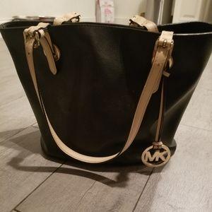 Michael Kors Bags - Michael Kors purse black  w/ tan straps